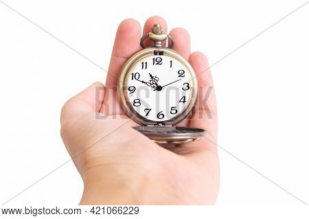 Close-up On A Bronze Pocket Watch In Hand Isolated On A White Background
