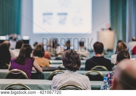 Audience In Lecture Hall Participating At Business Conference.