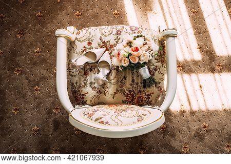 Bride's Bouquet. Bride Wedding Morning. Delicate Beige Shoes And A Wedding Bouquet. Bride's Accessor