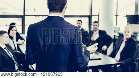 Successful Team Leader And Business Owner Leading Informal In-house Business Meeting. Businessman Wo