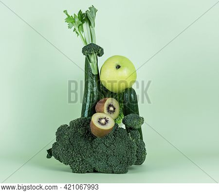 Fresh Green Vegetables And Fruits For A Healthy Smoothie Or Alkaline Diet. Equilibrium Floating Food