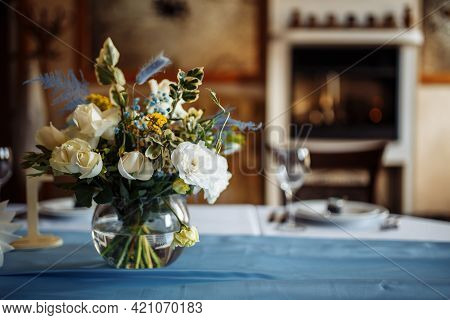 Table Set For An Event Party Or Wedding Reception. Flowers Bouquet On The Decorated Wedding Table. F