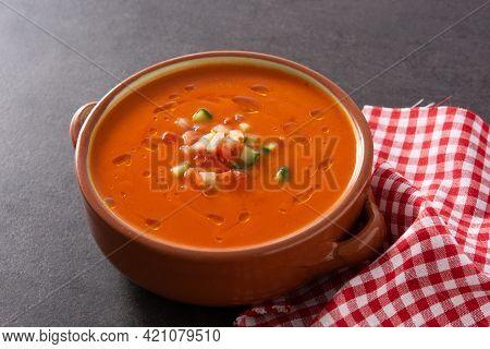 Gazpacho Soup In Crock Pot On Black Stone
