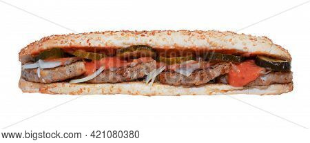 Long Sandwich Isolated On White Background. Quick Lunch - Sesame Bun. A Simple Sandwich With Cutlet,
