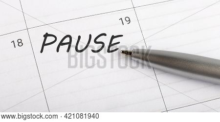 Text Pause On Calendar Planner To Remind You An Important Appointment With Pen On Isolated White Bac