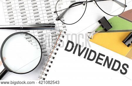 Dividends - The Inscription Of Text On The Notepad, And Chart. Business