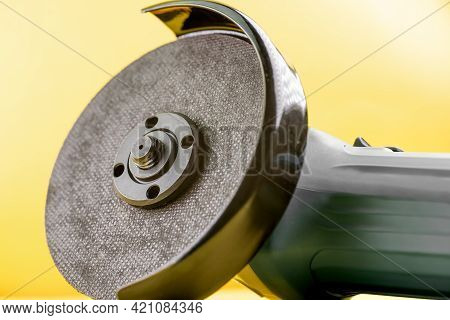 Grinder With Cutting Disc On Background.grinder With Cutting Disc On Background