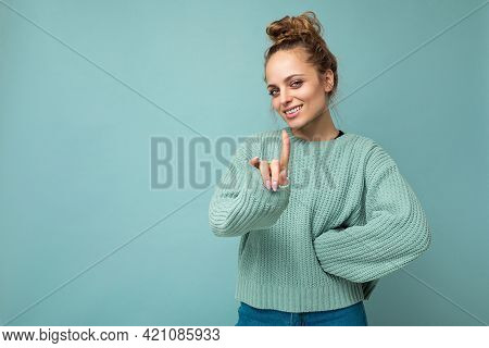 Portrait Of Young Happy Positive Attractive Blonde Woman With Sincere Emotions Wearing Casual Blue P