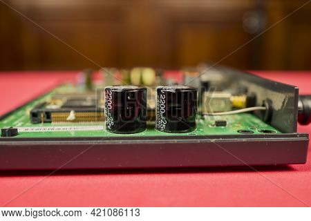 Several 470 µf Capacitors On A Printed Circuit