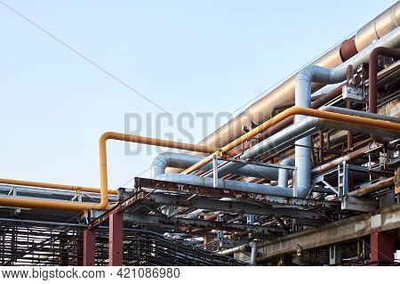 Pile Of Power Cabels And Steel Pipes With Gas, Oxigen Air Rust Covered With Traces Of Corrosion And