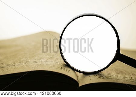 Seeking For An Answer. Antique Book With Magnifying Glass On It. Holy Bible Wisdom. Learning From Ol