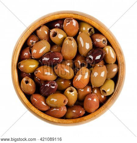 Pitted Leccino Olives, Preserved In Olive Oil, In A Wooden Bowl. Leccino, One Of The Primary Olive C