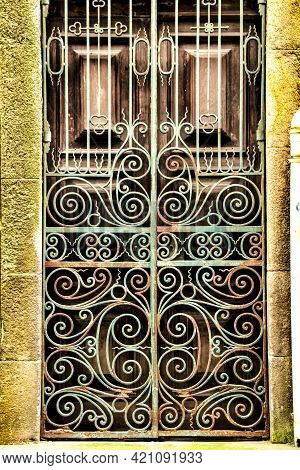 Old Wooden Green Door With Wrought Iron Fence In Porto, Portugal