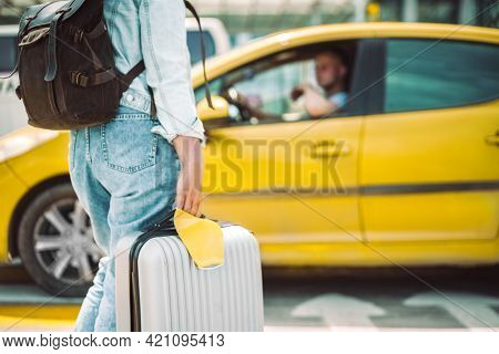 Woman Waiting For Taxi With Face Mask And Travel Case