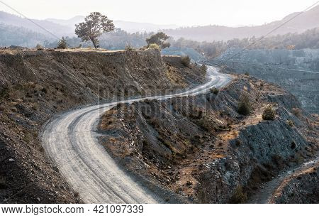 Winding Road For Trucks On A Terrace At Gravel Quarry. Landscape At Foggy Evening
