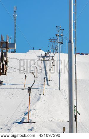 The Lift In The Ski Resort Moves Without People. Mountain Slope For Skiing And Snowboarding. Against