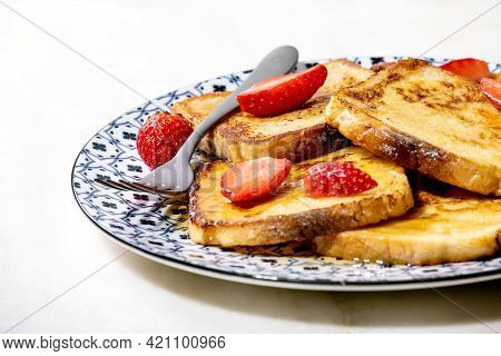 Stockpile Of French Toasts With Fresh Strawberries