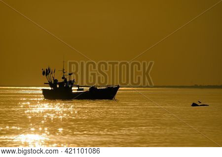 Fishing Boat - A Small Ship At Sea In The Sunny Morning