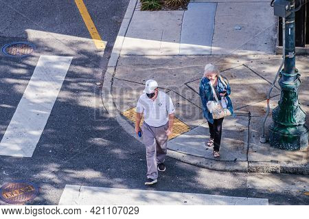 New Orleans, La - November 21: Man And Woman Step Into The Crosswalk Of A Downtown Street On Novembe