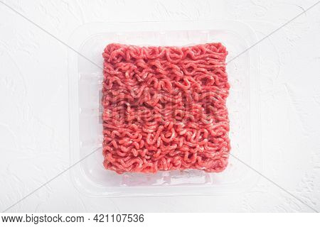 Raw Minced Meat In A Transparent Plastic Container Set, On White Stone  Background, Top View Flat La