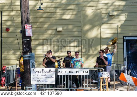 New Orleans, La - November 21: Brass Band Performs On The Sidewalk In Front Of Tipitina's Music Club