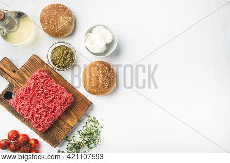 Raw Minced Meat With Pepper, Herbs And Spices For Cooking Meatball Burger Set, On Wooden Cutting Boa