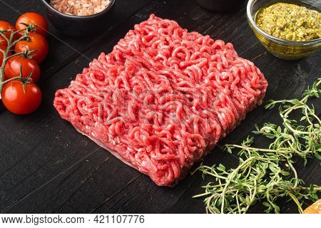 Homemade Minced Meat In A Black Bowl With Ingredients. Fresh Raw Mince For Cooking Meatballs Set, On
