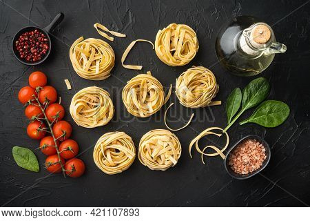 Pasta Tagliatelle With Ingredients Set, On Black Stone Background, Top View Flat Lay