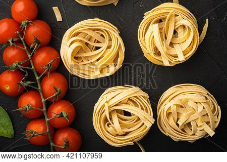 Cooking Tagliatelle Pasta And Ingredients Set, On Black Stone Background, Top View Flat Lay