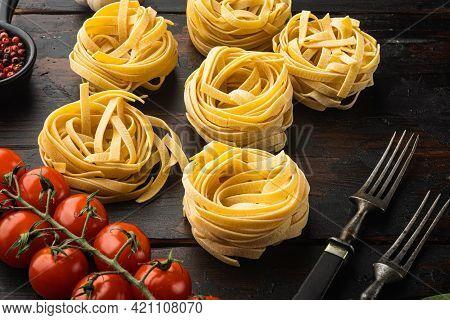 Pasta Ingredients Tagliatelle With Italian Food Ingredients Set, On Old Dark  Wooden Table Backgroun