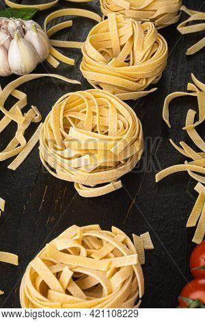 Fettuccine Tagliatelle Pasta Italian Food Ingredients Set, On Black Wooden Table Background
