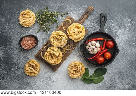 Cooking Tagliatelle Pasta And Ingredients Set, On Gray Stone Background, Top View Flat Lay