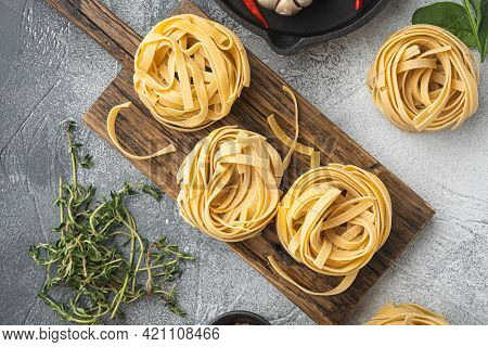 Pasta Ingredients Tagliatelle With Italian Food Ingredients Set, On Gray Stone Background, Top View