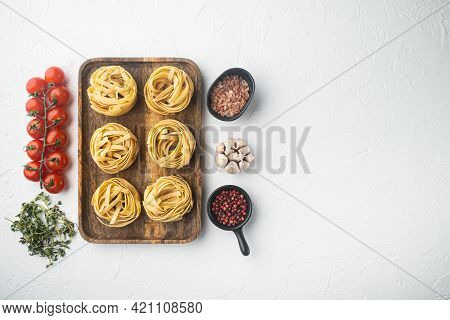 Raw Tagliatelle Nests Traditional Italian Pasta Set, On White Stone  Background, Top View Flat Lay,