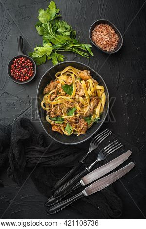 Homemade Rabbit Stew Pappardelle Set, In Bowl, On Black Stone Background, Top View Flat Lay