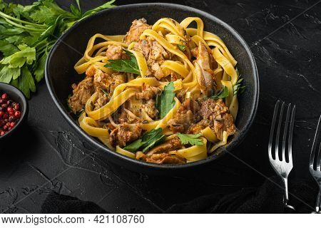 Wild Hare With Vegetable In White Wine Sauce Pasta Tagliatelle Or Pappardelle Set, In Bowl, On Black