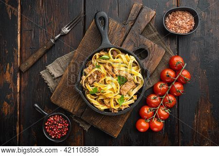 Homemade Rabbit Stew Pappardelle Set, In Frying Cast Iron Pan Or Pot, On Old Dark  Wooden Table, Top