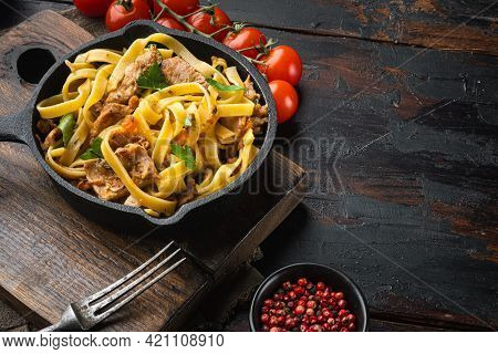 Homemade Rabbit Stew Pappardelle Set, In Frying Cast Iron Pan Or Pot, On Old Dark  Wooden Table, Wit