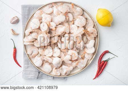 Frozen Peeled Boiled Prawns Set, On Plate, On White Background, Top View Flat Lay