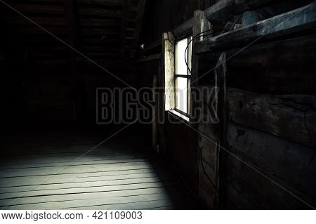 Horror Background Causing Fear. Scary Mystical Mysterious Dark Attic Room In An Abandoned Wooden Old