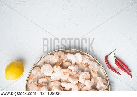 Frozen Peeled Boiled Prawns Set, On Plate, On White Background, Top View Flat Lay, With Copy Space F