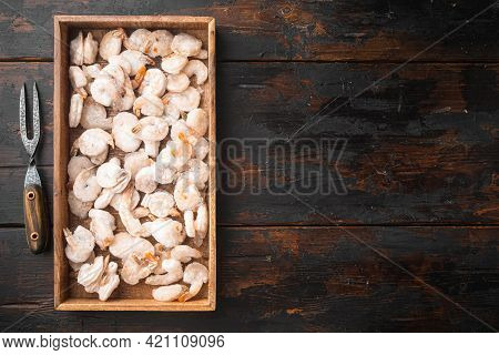 Pink Frozen Shrimps With Ice. Uncooked Peeled Seafood Set, In Wooden Box, On Old Dark  Wooden Table,