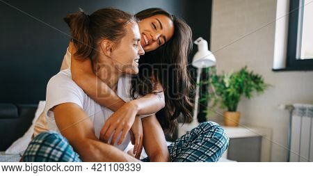 Sensual Foreplay By Happy Couple In Bedroom