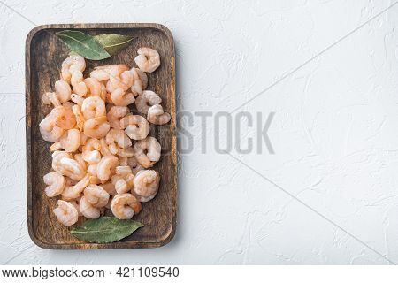 Boiled Peeled Shrimps, Prawns Set, On Wooden Tray, On White Stone  Background, Top View Flat Lay, Wi