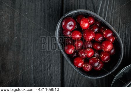 Cranberry, Ripe Red Berry In Bowl, Top View With Space For Text, On Black Wooden Background.