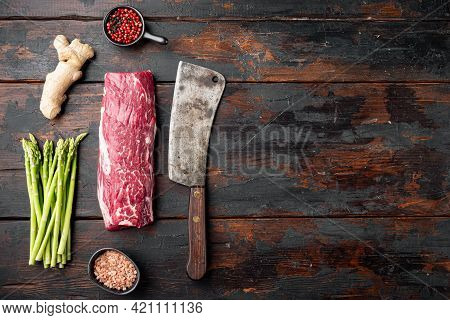 Fresh Raw Beef Steak Mignon Whole Cut Set , With Old Butcher Cleaver Knife, On Old Dark  Wooden Tabl