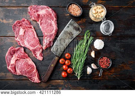 Rib Eye Ingredients With Beans Set, And Old Butcher Cleaver Knife, On Old Dark  Wooden Table Backgro