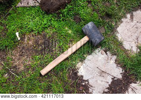 A Rubber Mallet Laying On Grass Outdoors