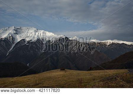 Russia. North-eastern Caucasus, Republic Of Dagestan. Snow Peaks Of Mountain Peaks Near The Village