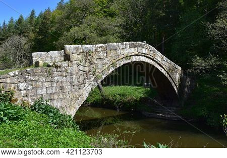 Historic Arched Stone Beggar's Bridge Over The River Esk In Glaisdale England.